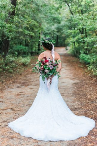 bride on woodland pathway