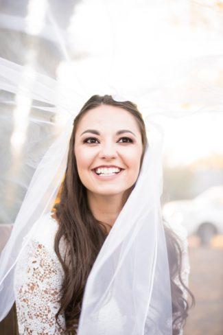 bride smiling under veil