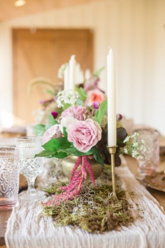 candles, moss, and flowers