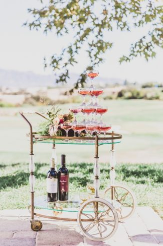 champagne tower on vintage serving cart