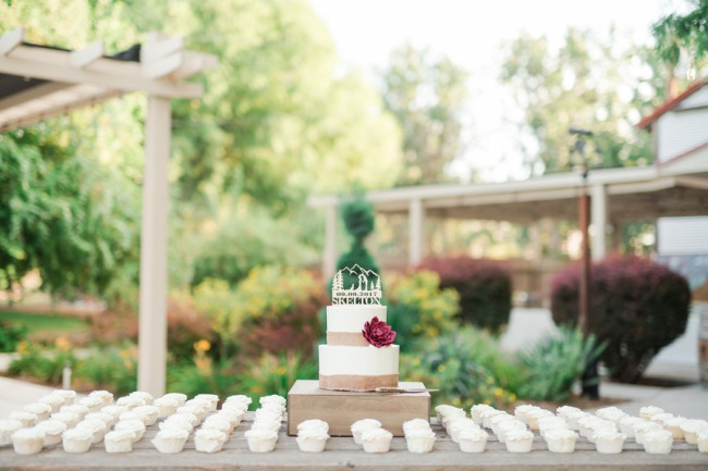 cupcake table with cake on stand