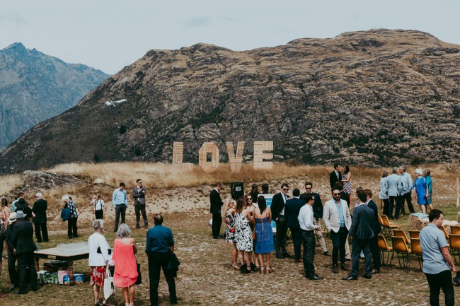giant LOVE sign on hill