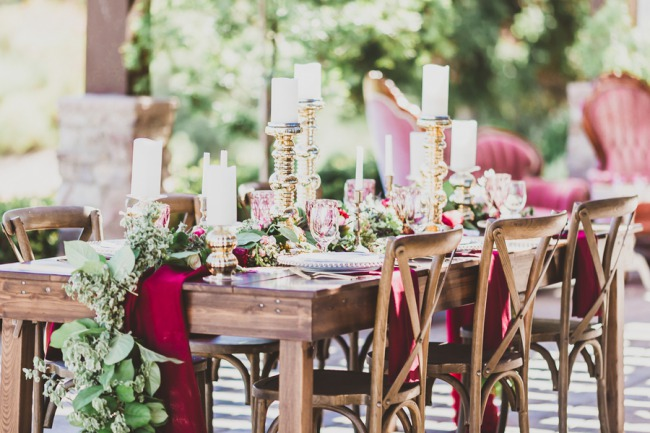 gold decor and greenery on wood tablescape