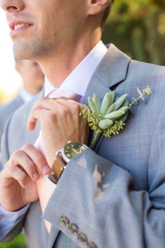 groom showing off watch