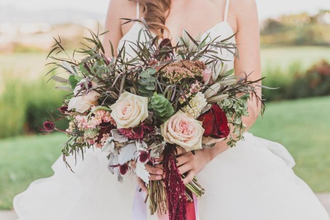 model holding bouquet