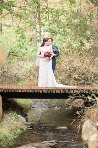 newlywed portrait on bridge