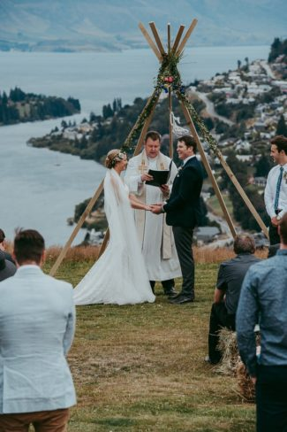 newlyweds saying vows at teepee alter