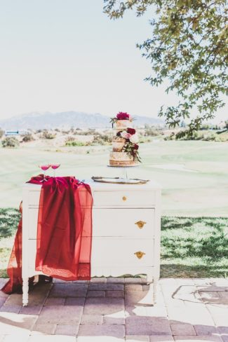 outdoor chest with cake and red sheer