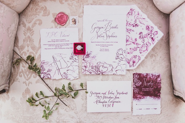 purple writing on white stationery suite