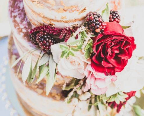real blackberries and flowers adorn cake