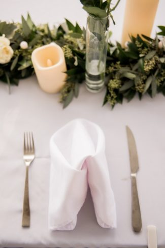 simple place setting with greenery