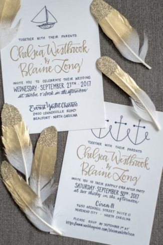 stationery with gold tipped feathers