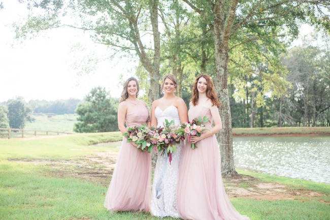 styled bridesmaids in light pink dresses