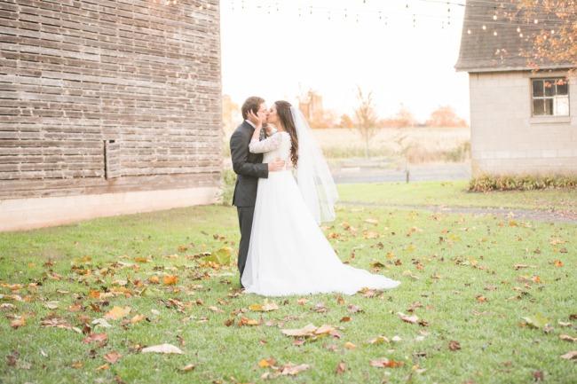styled couple near barn at Stonebrook Farm