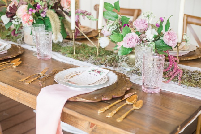 tablescape with gold cutlery and greenery