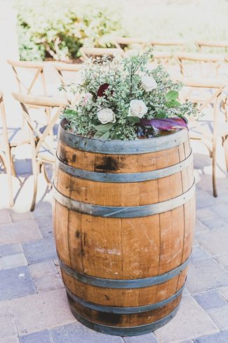 wine barrel with flowers on top