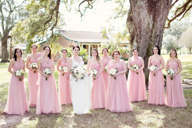 all bridesmaids in pink dresses