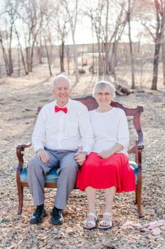 anniversary couple on love seat outdoors