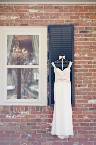bridal gown hanging outdoors on window