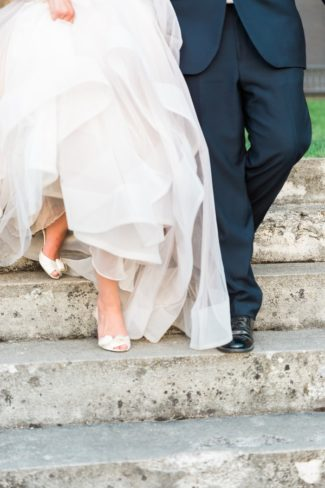 bride and groom's shoes walking down steps