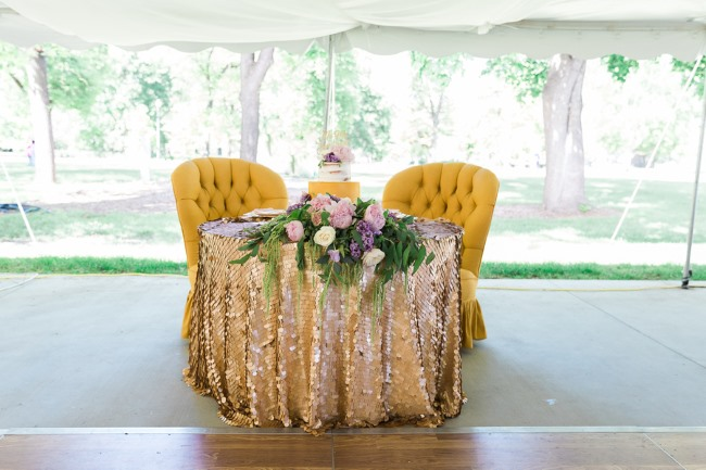 cake table with mustard color lounge chairs