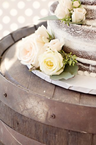 closeup of cake on wine barrel