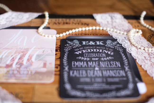 closeup of pearls and lace on chalkboard invite