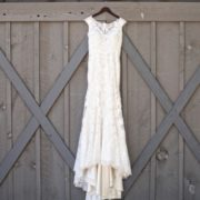 dress hanging against gray barn door