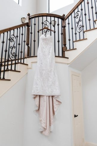 dress hanging from stair railing