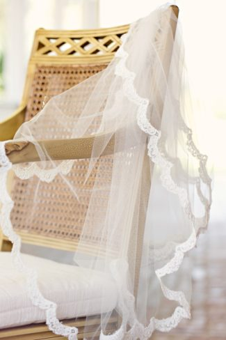 edged veil on chair