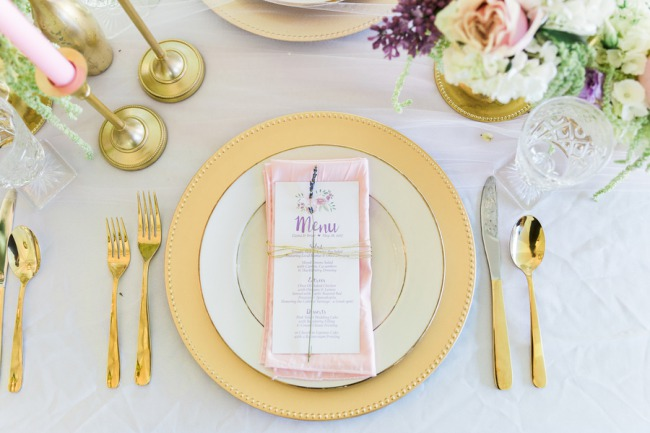gold charger with gold cutlery