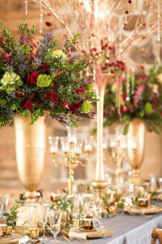 gold vases with flowers on table