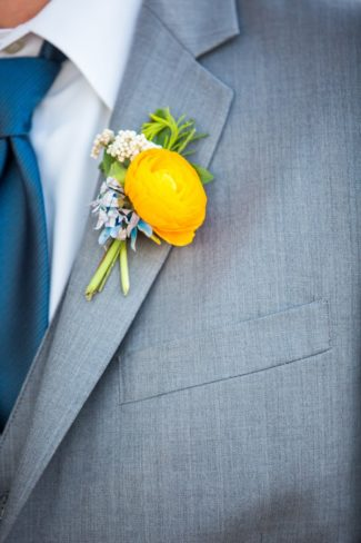 groom with boutonniere and cerulean blue tie