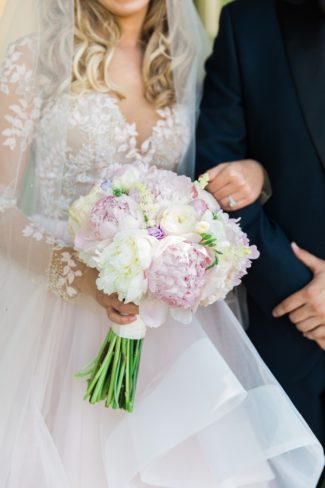 holding bridal bouquet