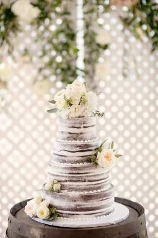 naked cake with white roses