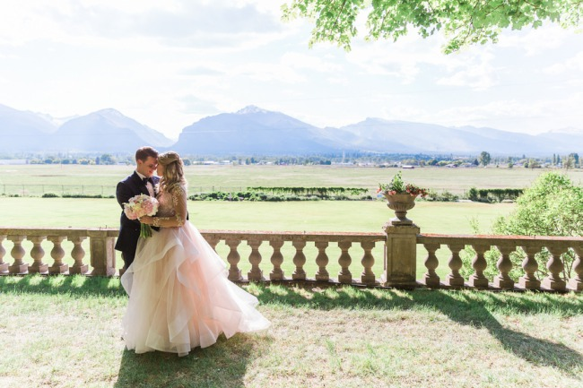 newlyweds at Daly Mansion outdoor terrace
