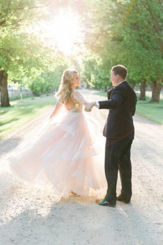 newlyweds walk on gravel path