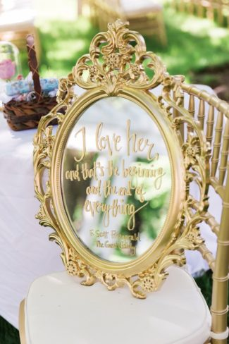 ornate gold framed mirror with message written