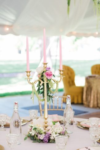 pink candles in candelabra on table