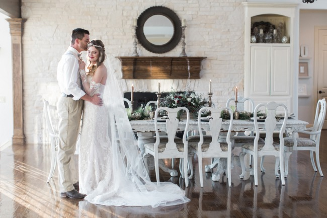 romantic couple at styled boho table