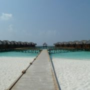 sandy beach water bungalows