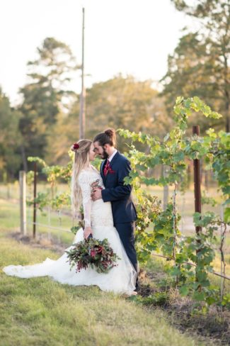 styled couple in vineyard