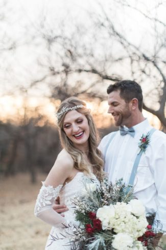 styled couple laughing outdoors
