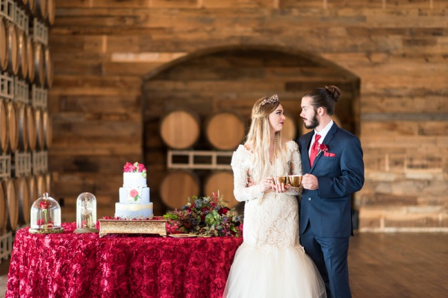 styled couple next to cake table