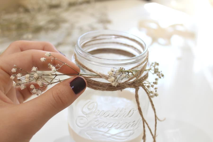 adding baby breath to mason jar