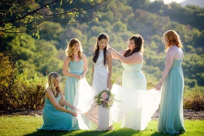 bridesmaids attend to bride dress