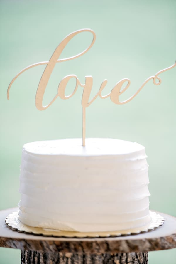 Buttercream Ruffle Cake With Love Cursive Topper