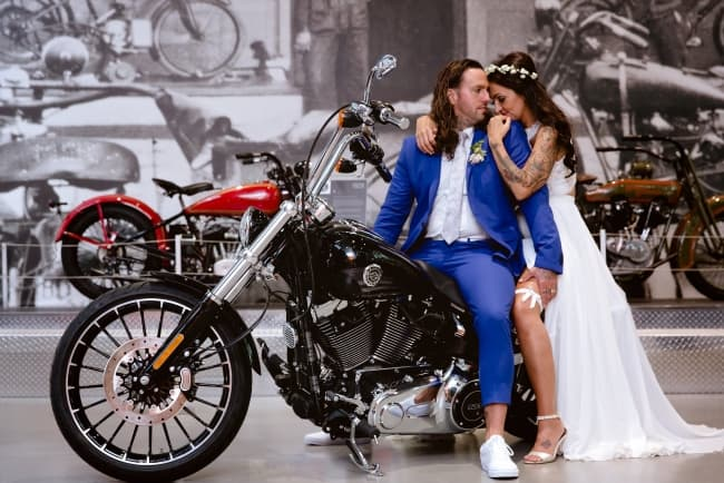 newlyweds on Harley Davidson motorcycle