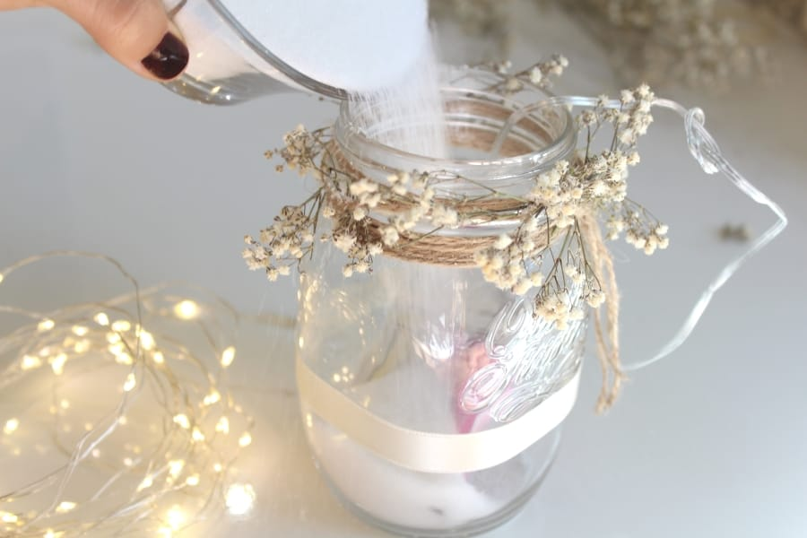 pouring epsom salts into mason jar