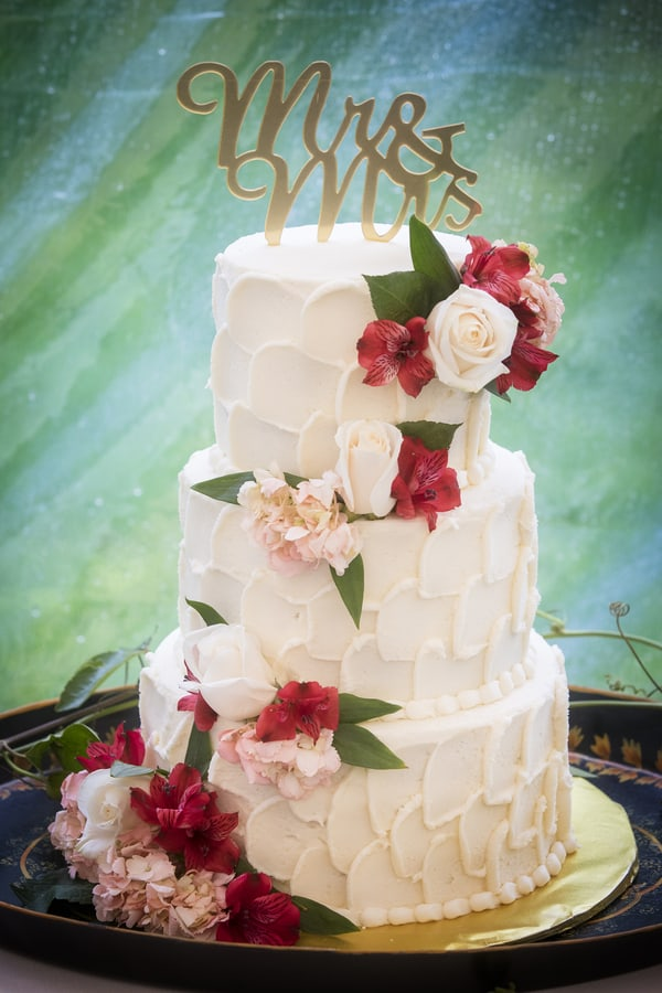 three-tier Textured Buttercream cake with floral embellishments